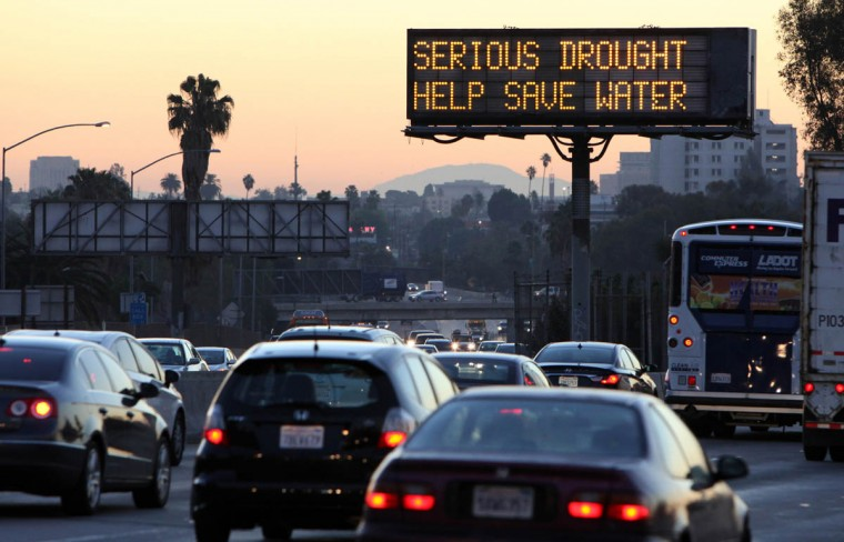 "Morning traffic makes its way toward downtown Los Angeles along the Hollywood Freeway past an electronic sign warning of severe drought. From drought-shaming to eco-boasting, willing or not, celebrities play a role in raising awareness about the debilitating drought in Calif. ""We're all in this together,"" said actress Wendie Malick. ""Unfortunately, it had to come to this crisis moment to get us all on board."" (Richard Vogel/AP photo)"