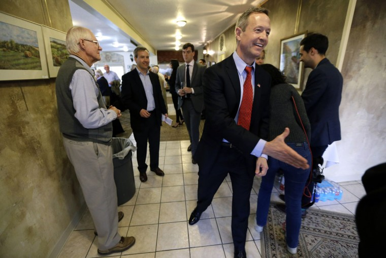 FILE - In this April 9, 2015 file photo, former Maryland Gov. Martin O'Malley greets local residents before speaking at a fundraiser in Indianola, Iowa. O'Malley has spent months investing in Iowa, aiming to repeat the trick pulled by Barack Obama in 2008, when the then-underdog upstart challenger to favorite Hillary Rodham Clinton won the state's caucuses and began his march to the Democratic presidential nomination. (AP Photo/Charlie Neibergall, File)