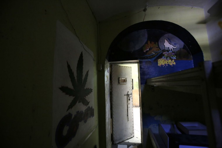 In this April 9, 2015 photo, murals decorate the walls of a cell inside the now empty Garcia Moreno Prison, during a guided tour for the public in Quito, Ecuador. According to tour guides, cell sizes vary, with the smallest being eight square meters (86 square feet), designed to hold two inmates but which actually held up to eight, and the largest cell being 30 square meters (322 square feet) which held as many as 40 people. However, prisoners with money could pay the gangs that controlled daily life inside to give them a cell with just one roommate. (AP Photo/Dolores Ochoa)