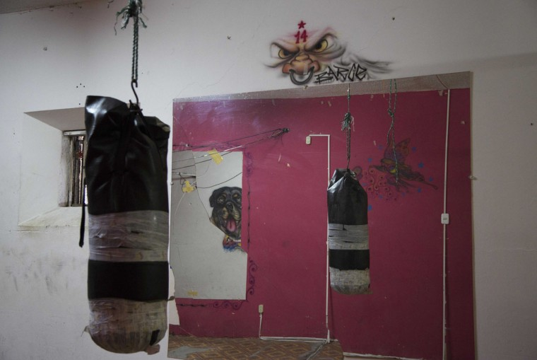 This April 14, 2015 photo shows a punching bag hanging inside the gym, also reflected in a mirror, at the now empty Garcia Moreno Prison, during a guided tour for the public in Quito, Ecuador. Prisoner access to the gym was considered a privilege. (AP Photo/Dolores Ochoa)
