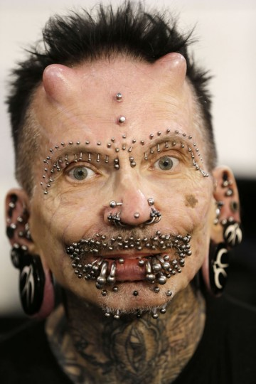Rolf Buchholz, 56, poses for a photograph during the annual Athens Tattoo Convention in Athens, Sunday, May 17, 2015. Buchholz, an information technology professional from Dortmund, Germany has 453 piercings and is the holder of a Guinness World Record. About 230 artists from Greece and abroad took part in the three-day event attracted thousands of visitors. (AP Photo/Thanassis Stavrakis)