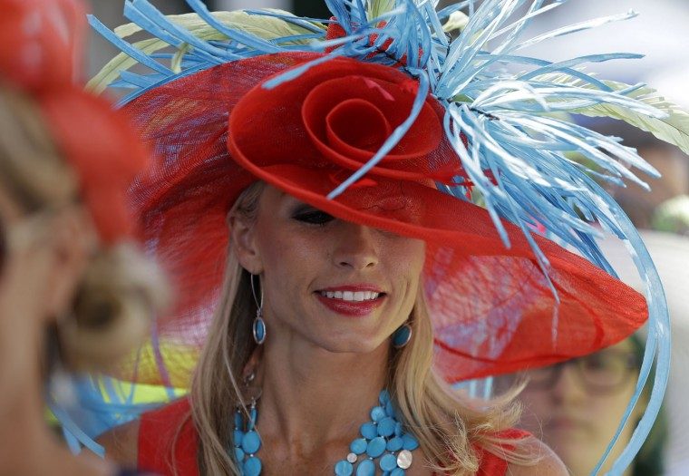 Nichole Whelan wears a hat before the 141st running of the Kentucky Derby horse race at Churchill Downs Saturday, May 2, 2015, in Louisville, Ky. (AP Photo/David J. Phillip)