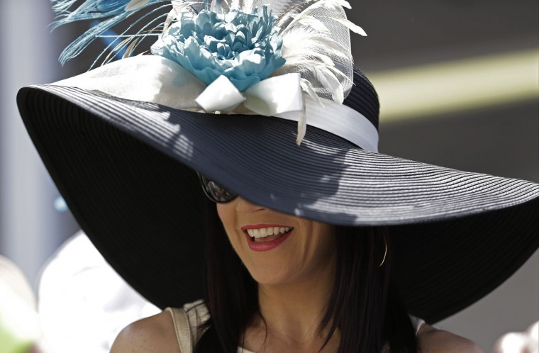 Jenny Paul wears a hat before the 141st running of the Kentucky Derby horse race at Churchill Downs Saturday, May 2, 2015, in Louisville, Ky. (AP Photo/David J. Phillip)