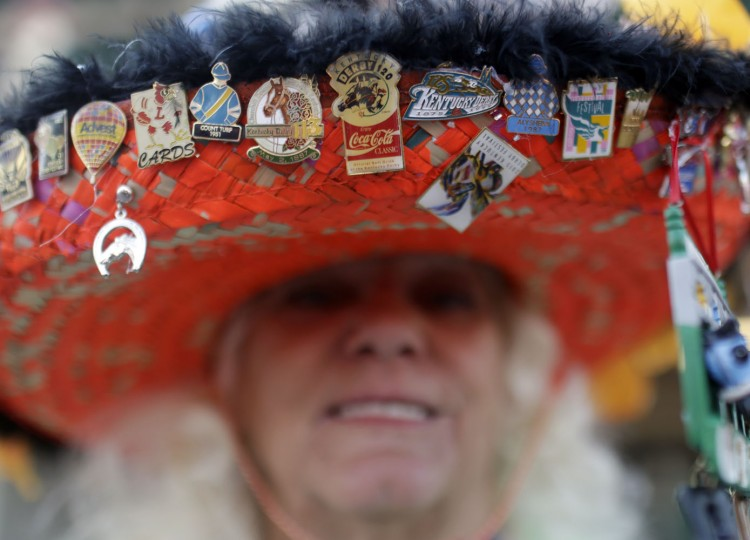 Ginny Keen wears a hat before the 141st running of the Kentucky Derby horse race at Churchill Downs Saturday, May 2, 2015, in Louisville, Ky. (AP Photo/Brynn Anderson)