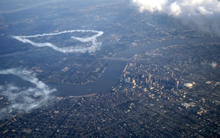 In this aerial photo, skywriter Nathan Hammond draws a heart over the Mississippi River and New Orleans, Saturday, May 2, 2015. Hammond was commissioned by local entrepreneur Frank Scurlock to write positive, inspiring messages over the city during the New Orleans Jazz and Heritage Festival. (AP Photo/Gerald Herbert)