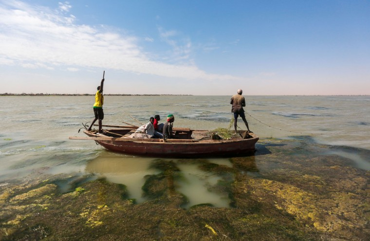 In this Wednesday, April 15, 2015 photo, Sudanese fishermen sail through river algae while fishing on the Nile River on the outskirts of Khartoum, Sudan. The worldís longest river, the Nile courses through 11 countries, ending in Egypt and the Mediterranean Sea. Its main tributaries, the Blue and the White Niles, meet just north of Khartoum. (AP Photo/Mosa'ab Elshamy)