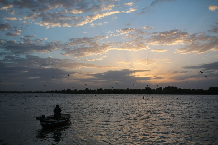 In this Thursday, April 16, 2015 photo, a Sudanese fisherman prepares to sail his boat at the start of the day at the Nile River, in Omdurman, Khartoum, Sudan. (AP Photo/Mosa'ab Elshamy