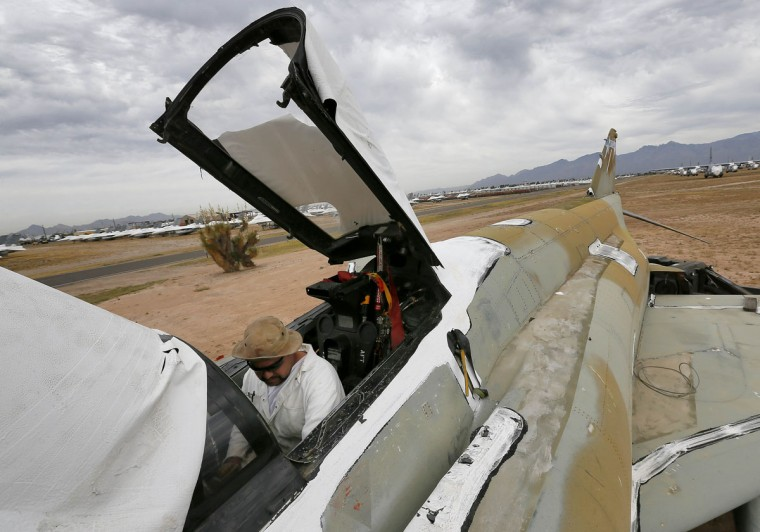 A demilitarization crew member removes components from the cockpit of an F-4 Phantom slated for destruction at the 309th Aerospace Maintenance and Regeneration Group boneyard in Tucson, Ariz., on Thursday, May 21, 2015. The 309th is the United States Air Forceís aircraft and missile storage and maintenance facility and provides long and short-term aircraft storage, parts reclamation and disposal. (AP Photo/Matt York)