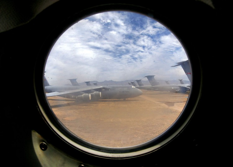 A field of Lockheed C-5 Galaxy cargo jets are seen through a window from another C-5 at the 309th Aerospace Maintenance and Regeneration Group boneyard at Davis-Monthan Air Force Base in Tucson, Ariz., on Thursday, May 21, 2015. The C-5A Galaxy is the largest aircraft in the U.S. armed services. The C-5 has a wingspan of over 222 feet and stands over 65 feet high has been used by the Air Force continually since 1969. (AP Photo/Matt York)