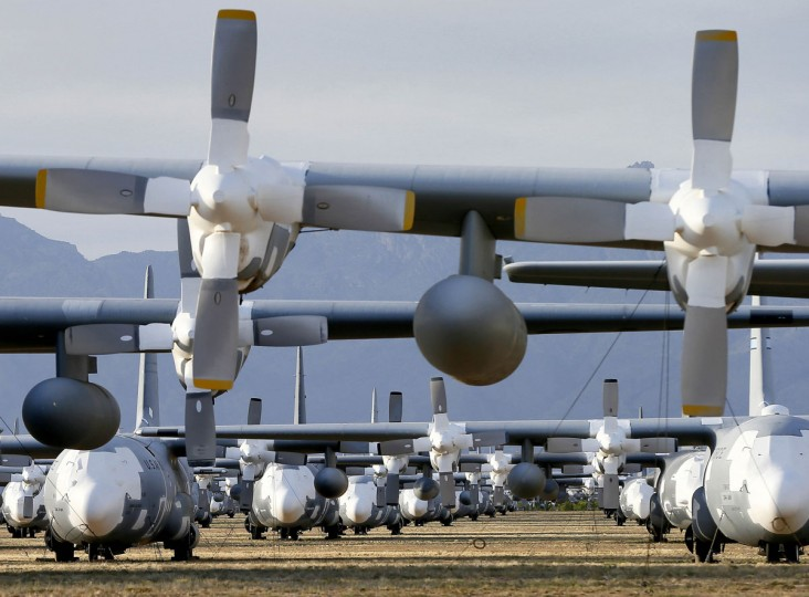 In this photo taken on Thursday, May 14, 2015, C-130 Hercules cargo planes are lined up in a field at the 309th Aerospace Maintenance and Regeneration Group boneyard at Davis-Monthan Air Force Base in Tucson, Ariz. Over 2,300 variants of the C-130 have been produced since 1954. (AP Photo/Matt York)