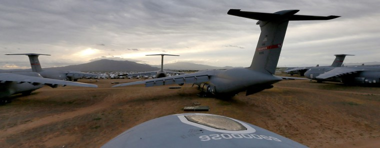 A field of Lockheed C-5 Galaxy cargo jets are shown at sunrise at the 309th Aerospace Maintenance and Regeneration Group boneyard Friday, May 15, 2015 at Davis-Monthan Air Force Base in Tucson, Ariz. The C-5A Galaxy the largest aircraft in the U.S. armed services. (AP Photo/Matt York)