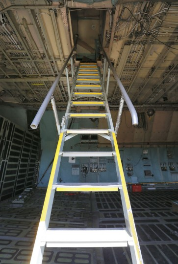 A ladder leads to the cockpit from the cargo area of a Lockheed C-5 Galaxy cargo jet at the 309th Aerospace Maintenance and Regeneration Group boneyard Friday, May 15, 2015 at Davis-Monthan Air Force Base in Tucson, Ariz. Some aircraft at the boneyard are reclaimed to keep existing fleets in service. (AP Photo/Matt York)
