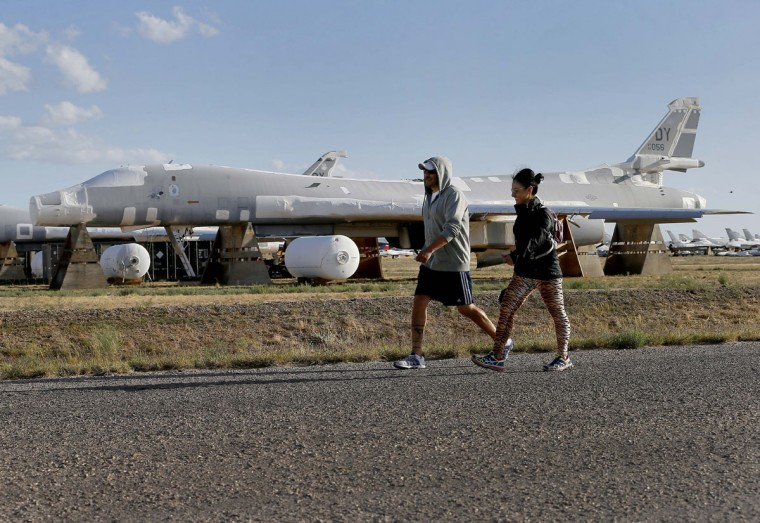 309th Aerospace Maintenance and Regeneration Group employees walk past a Rockwell B-1 Lancer bomber at the boneyard, Thursday, May 14, 2015 at Davis-Monthan Air Force Base in Tucson, Ariz. The B1 was developed as a heavy strategic bomber for the United States Air Force and is still in use today. (AP Photo/Matt York)