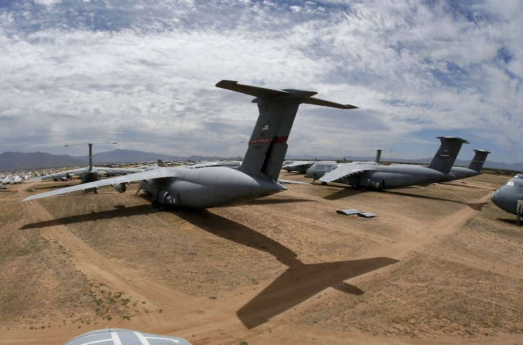 Lockheed C-5 Galaxy cargo jets are stored, as shown with this fisheye lens photograph, at the 309th Aerospace Maintenance and Regeneration Group boneyard Thursday, May 14, 2015 at Davis-Monthan Air Force Base in Tucson, Ariz. The C-5A Galaxy the largest aircraft in the U.S. armed services. (AP Photo/Matt York)