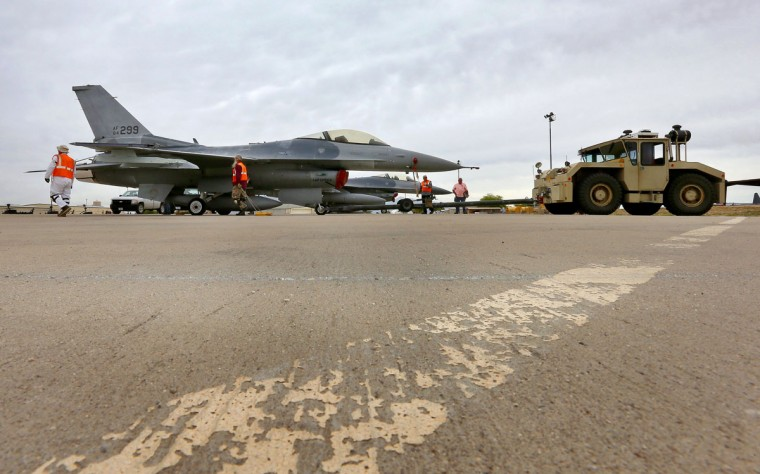 "A boneyard crew tows an General Dynamics F-16 Fighting Falcon prior to the preservation process after its arrival at the 309th Aerospace Maintenance and Regeneration Group, Friday, May 15, 2015 at Davis-Monthan Air Force Base in Tucson, Ariz. The ""boneyard"" is worldís largest military aircraft storage and preservation facility. (AP Photo/Matt York)"