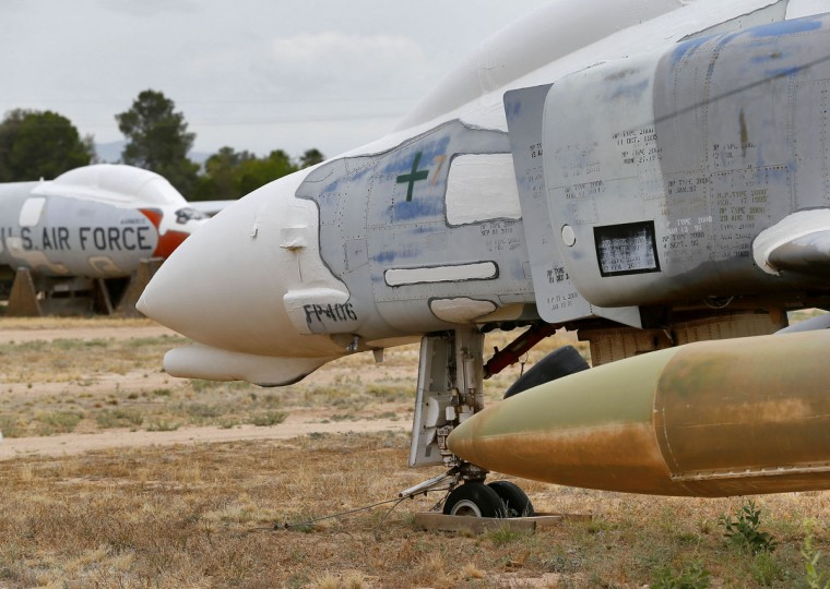 The side of a McDonnell Douglas F-4 Phantom II is shown stored at the 309th Aerospace Maintenance and Regeneration Group boneyard, Thursday, May 14, 2015 at Davis-Monthan Air Force Base in Tucson, Ariz. (AP Photo/Matt York)