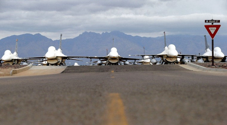 F-16 Fighting Falcons sit in a field along Miami St. at the 309th Aerospace Maintenance and Regeneration Group boneyard, Friday, May 15, 2015 at Davis-Monthan Air Force Base in Tucson, Ariz. Over 4,500 variants of the F-16's have been produced since 1973. This field of fighters will become drone target planes in the future. (AP Photo/Matt York)
