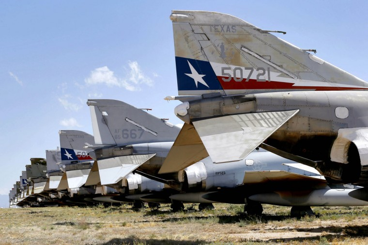 A row of McDonnell Douglas F-4 Phantom II's are stored at the 309th Aerospace Maintenance and Regeneration Group boneyard, Thursday, May 14, 2015 at Davis-Monthan Air Force Base in Tucson, Ariz. (AP Photo/Matt York)