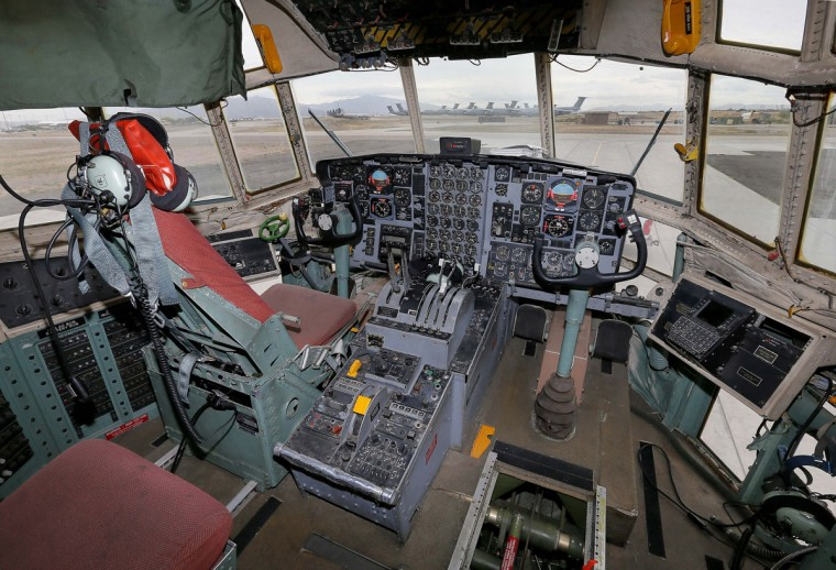Fields of aircraft can be seen through the cockpit of a 1974 Lockheed KC-130R Hercules at the 309th Aerospace Maintenance and Regeneration Group boneyard Friday, May 15, 2015 at Davis-Monthan Air Force Base in Tucson, Ariz. This aircraft is one of six 6 used KC-130Rs being restored after being sold to the Japan Maritime Self-Defense Force. (AP Photo/Matt York)