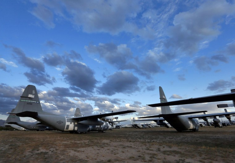 C-130 Hercules cargo planes are lined up in a field at the 309th Aerospace Maintenance and Regeneration Group boneyard Thursday, May 14, 2015 at Davis-Monthan Air Force Base in Tucson, Ariz. (AP Photo/Matt York)