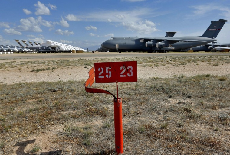 Boeing Vertol CH-46 Sea Knights, far left, and Sikorsky MH-53's, center, face Lockheed C-5 Galaxy cargo jets, right, in a field at the 309th Aerospace Maintenance and Regeneration Group boneyard Thursday, May 14, 2015 at Davis-Monthan Air Force Base in Tucson, Ariz. (AP Photo/Matt York)