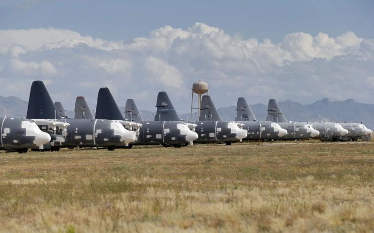 Air Force Lockheed MC-130H Hercules' are stored at the 309th Aerospace Maintenance and Regeneration Group boneyard, Thursday, May 14, 2015 at Davis-Monthan Air Force Base in Tucson, Ariz. (AP Photo/Matt York)