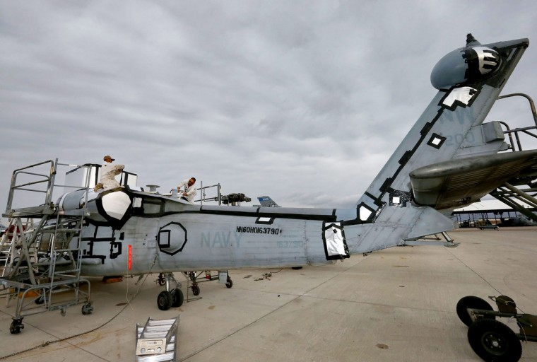 "Mechanics from the 309th Aerospace Maintenance and Regeneration Group boneyard prepare a U.S. Navy Sikorsky SH-60 Seahawk for storage after it's arrival, Friday, May 15, 2015 at Davis-Monthan Air Force Base in Tucson, Ariz. The ""boneyard"" is worldís largest military aircraft storage and preservation facility. (AP Photo/Matt York)"