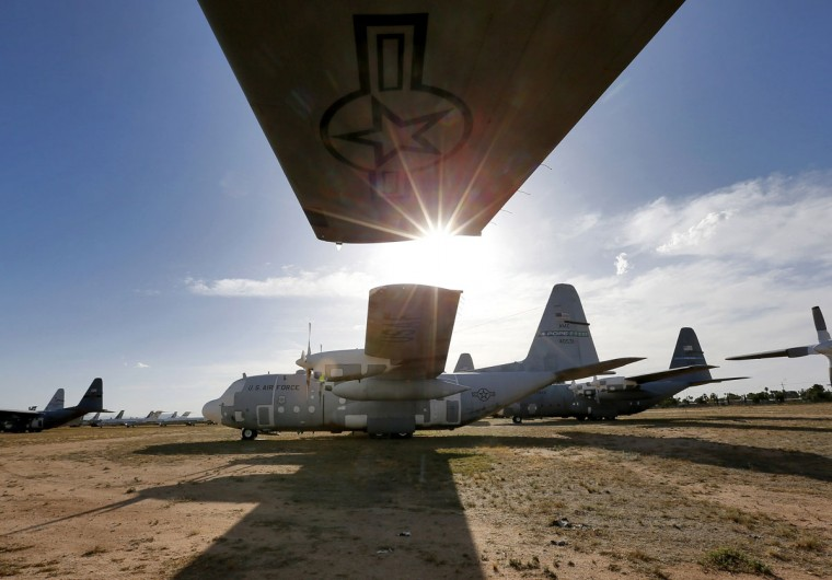 Numerous C-130 cargo planes are lined up in a field at the 309th Aerospace Maintenance and Regeneration Group boneyard Thursday, May 14, 2015 at Davis-Monthan Air Force Base in Tucson, Ariz. (AP Photo/Matt York)
