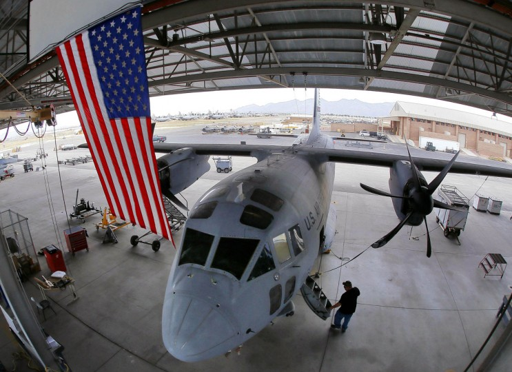 A U.S. Coast Guard C-27J is undergoing regeneration in the maintenance shelter at the 309th Aerospace Maintenance and Regeneration Group boneyard as shown in this fisheye lens photograph, Thursday, May 21, 2015, in Tucson, Ariz. The 309th is the United States Air Forceís aircraft and missile storage and maintenance facility and provides long and short-term aircraft storage, parts reclamation and disposal. (AP Photo/Matt York)