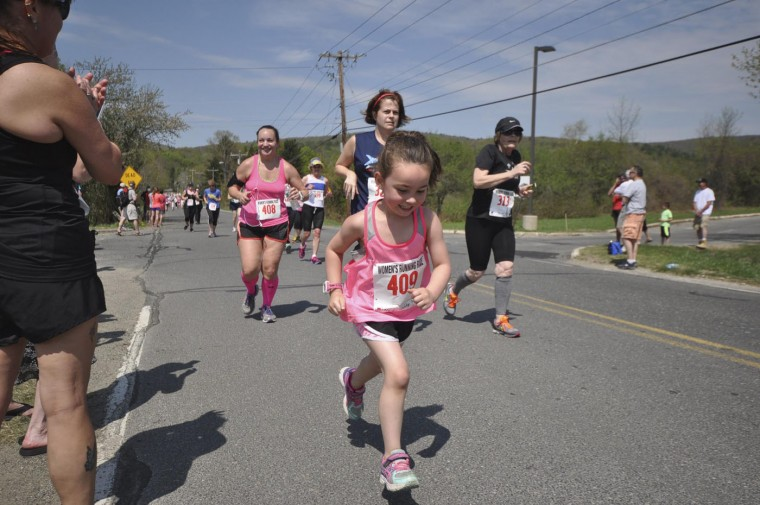 Runners of all ages take off the start of the two mile race at Berkshire Community College for the 38th Annual Women's Running Race on Mother's Day in Pittsfield, Mass., Sunday, May, 10, 2015. (AP-Photo/The Berkshire Eagle, Gillian Jones)