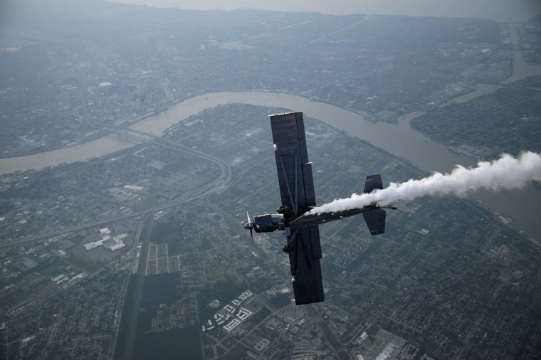 Skywriter Nathan Hammond writes a message over the Mississippi River and New Orleans, Saturday, May 2, 2015. Hammond was commissioned by local entrepreneur Frank Scurlock to write positive, inspiring messages over the city during the New Orleans Jazz and Heritage Festival. (AP Photo/Gerald Herbert)