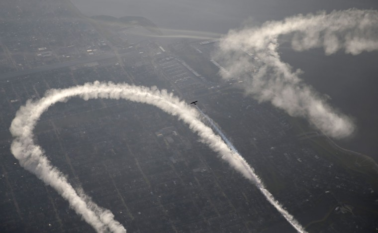 In this May 2, 2015 photo, skywriter Nathan Hammond writes messages of hope and love over New Orleans, during the New Orleans Jazz & Heritage Festival. (AP Photo/Gerald Herbert)
