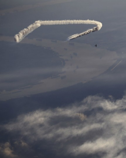 In this May 2, 2015 photo, skywriter Nathan Hammond writes messages of hope and love over New Orleans, during the New Orleans Jazz & Heritage Festival. Hammond estimates the letters to be about a mile tall although they could stretch up to ten miles, depending on the message. (AP Photo/Gerald Herbert)