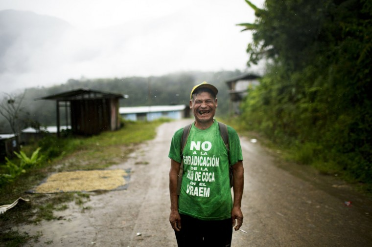 "In this March 15, 2015 photo, Fortunato Farfan laughs while posing for a photo in La Mar, province of Ayacucho, Peru. Fortunato is wearing a T-shirt with a phrase that reads in Spanish; ""No to coca eradication in the VRAEM."" VRAEM is the acronym for Valley of the Apurimac, Ene and Mantaro rivers, where sixty percent of Peruís cocaine originates. (AP Photo/Rodrigo Abd)"