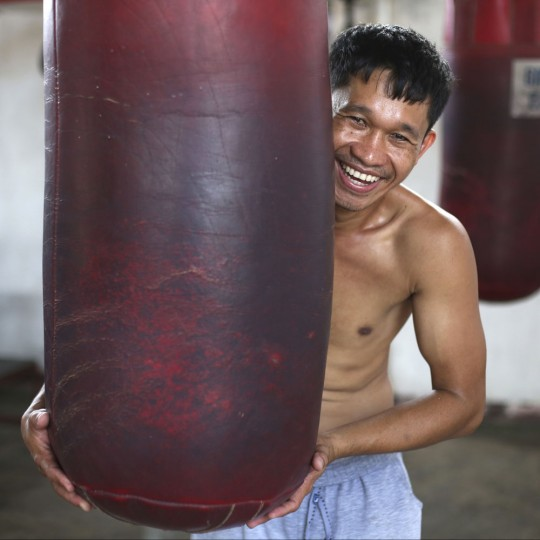 "In this April 21, 2015, photo, retired Filipino boxer and now trainer Rexon Flores poses inside a boxing gym in suburban Paranaque, south of Manila, Philippines. Flores, 33, said, ìThey all want to be champions ... but the most important thing is to not be swell-headed. If you become swell-headed, your boxing skills will suffer. You will just fool around and you will lose focus on boxing. ""Discipline is primary. If you don't have discipline, all your dreams will just flow away like water."" (AP Photo/Aaron Favila)In this April 21, 2015, photo, retired Filipino boxer and now trainer Rexon Flores poses inside a boxing gym in suburban Paranaque, south of Manila, Philippines. Flores, 33, said, ìThey all want to be champions ... but the most important thing is to not be swell-headed. If you become swell-headed, your boxing skills will suffer. You will just fool around and you will lose focus on boxing. ""Discipline is primary. If you don't have discipline, all your dreams will just flow away like water."" (AP Photo/Aaron Favila)"