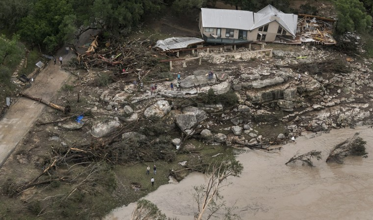 This aerial photo shows a home along the Blanco River that was taken off its foundation after rain caused flash flooding in Wimberley, Texas, Sunday, May 24, 2015. Record rainfall was wreaking havoc across a swath of the U.S. Midwest on Sunday, causing flash floods in normally dry riverbeds, spawning tornadoes and forcing at least 2,000 people to flee. (Rodolfo Gonzalez/Austin American-Statesman via AP)