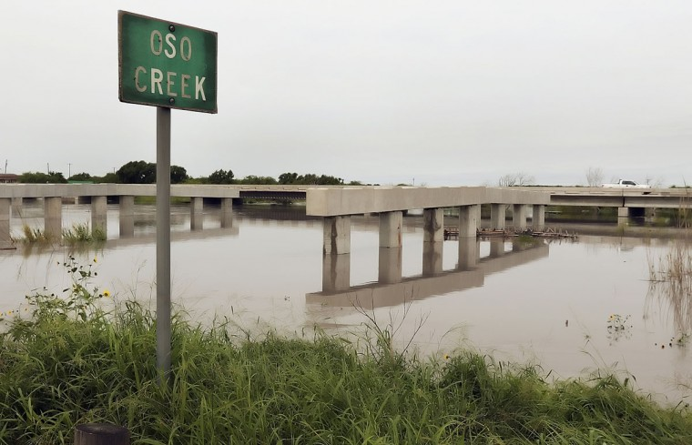 Flooding has stopped work on the new Oso Creek Bridge in Corpus Christi, Texas, Tuesday, May 12, 2015. Flash flooding in the region closed roads and forced some East Texas residents from their homes. (George Tuley/Corpus Christi Caller-Times via AP)
