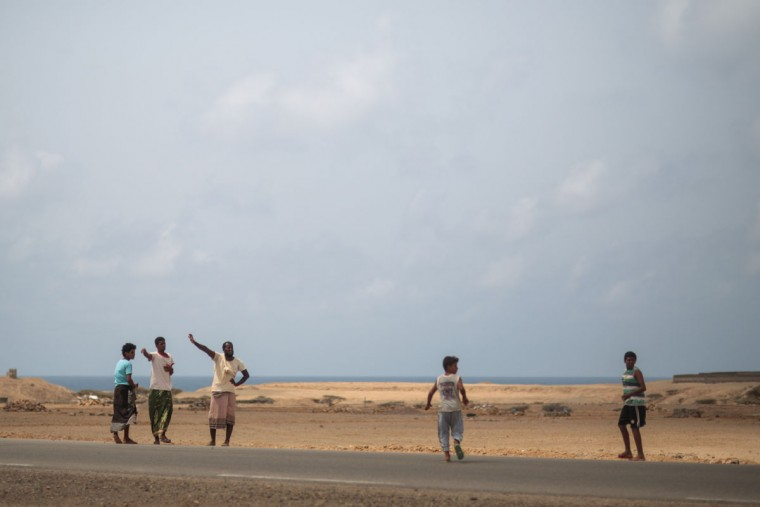Yemeni refugees gesture trying to hitchhike a ride from their camp to the center of Obock city, to the nearest shop, northern Djibouti. (AP Photo/Mosa'ab Elshamy)