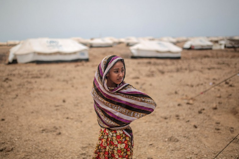 Ashwaq, 12, stands outside her family's tent, at the Markaze refugee camp in Obock, northern Djibouti. (AP Photo/Mosa'ab Elshamy)