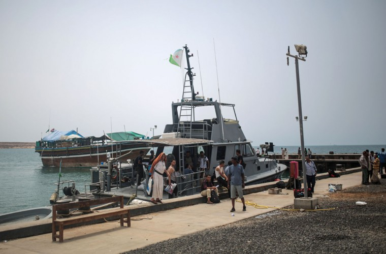 Newly-arrived Yemeni refugees wait at the Obock port in northern Djibouti. Many of the refugees arrived with just the few belongings they could carry, mostly on small rickety fishing boats, others on bigger vessels crammed with people, reversing a centuries-old perilous route that has seen countless African migrants take to the seas in the other direction. (AP Photo/Mosa'ab Elshamy)
