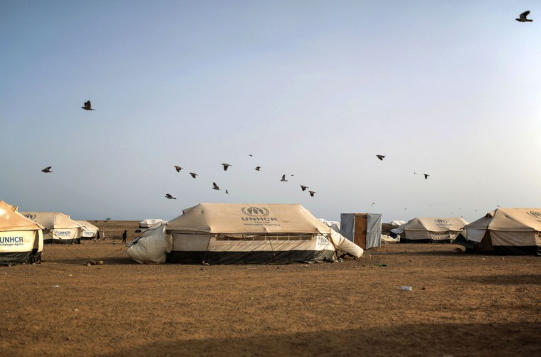 Pigeons fly over the Markaze refugee camp where Yemeni refugees are stationed in Obock, Djibouti. Many of the refugees are relieved to have escaped after two months of Saudi-led airstrikes targeting Yemenís Shiite rebels and fighting on the ground between rival factions that have pushed their country to the brink of collapse. (AP Photo/Mosa'ab Elshamy)