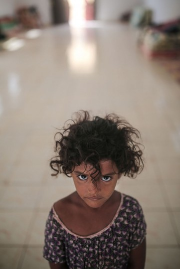 Aseya, 3, poses for a photo in her family's room in at an orphanage that has been turned into a center for Yemeni refugees, in Obock, northern Djibouti. Fleeing the war at home, thousands of Yemenis have made it across the Gulf of Aden to find refuge in Djibouti, a sleepy Horn of Africa nation where the United Nations has set up a staging hub for aid for the conflict-torn Arab country. (AP Photo/Mosa'ab Elshamy)