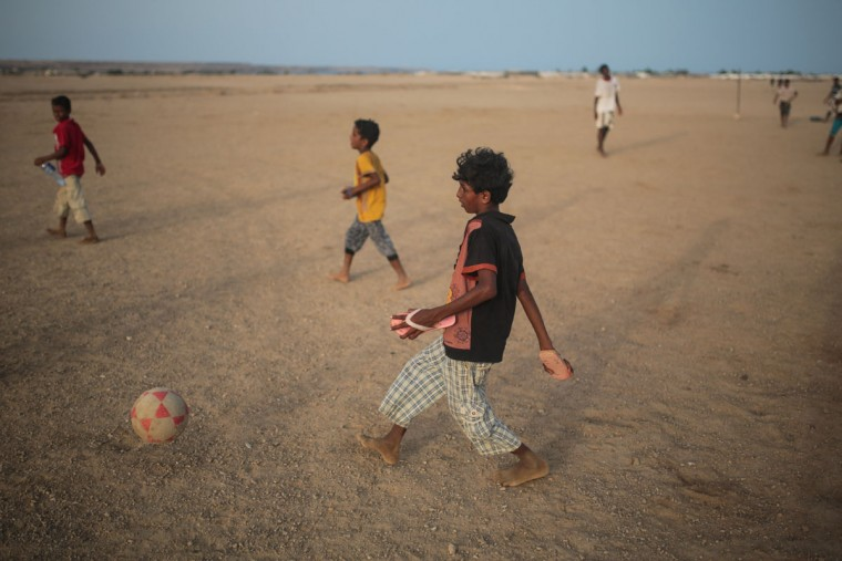 Yemeni refugee boys play football outside their camp, in Obock, northern Djibouti. Many of the refugees are relieved to have escaped after two months of Saudi-led airstrikes targeting Yemenís Shiite rebels and fighting on the ground between rival factions that have pushed their country to the brink of collapse. (AP Photo/Mosa'ab Elshamy)