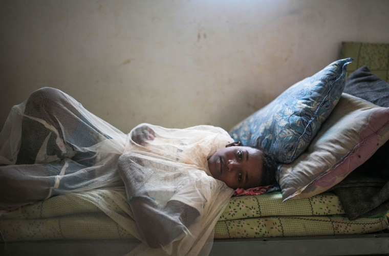 Abo Bakr Mohammed, 12, who suffers from epilepsy, covers himself with a mosquito net in his family's room, at an orphanage that has been turned into a center for Yemeni refugees, in Obock, northern Djibouti. The UNHCR says a total of 5,000 Yemeni refugees have made it to Djibouti, including 3,000 in the capital, Djibouti city, and 1,000 in Obock, 300 kilometers (187 miles) to the north making it currently the biggest Yemeni refugee population. (AP Photo/Mosa'ab Elshamy)