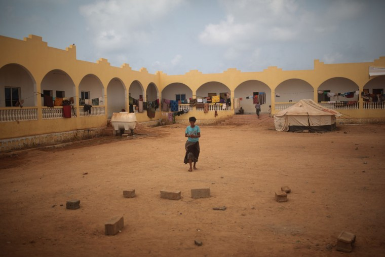 A Yemeni refugee walks at the yard of an orphanage that has been turned into a center for Yemeni refugees, in Obock, northern Djibouti. The Al-Rahma orphanage has become home to about 100 families, mostly from the Yemeni town of Bab Al-Mandab just a 30-minute boat trip from Obock. (AP Photo/Mosa'ab Elshamy)