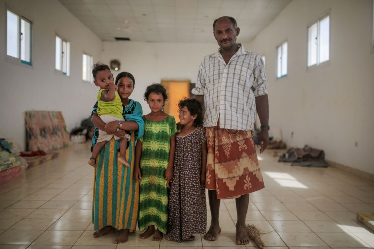 Ibrahim Omar, 45, right, and his children, Aseya, 3, Heyam, 6, Maryam, 10, and 1-year-old Saeed, pose for a photo as they stand next to their father in their room, at an orphanage that has been turned into a center for Yemeni refugees, in Obock, northern Djibouti. In Obock, the Al-Rahma orphanage has become home to about 100 families, mostly from the Yemeni town of Bab Al-Mandab just a 30-minute boat trip from Obock. (AP Photo/Mosa'ab Elshamy)