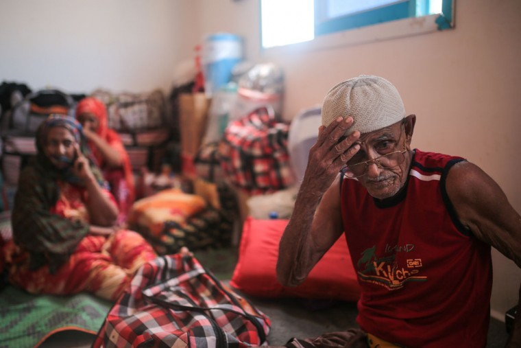 Ibrahim Mohamed, 80, and the oldest refugee at the center, who is both blind and deaf, adjusts his hat, at an orphanage that has been turned into a center for Yemeni refugees, in Obock, northern Djibouti. Fleeing the war at home, thousands of Yemenis have made it across the Gulf of Aden to find refuge in Djibouti, a sleepy Horn of Africa nation where the United Nations has set up a staging hub for aid for the conflict-torn Arab country. (AP Photo/Mosa'ab Elshamy)