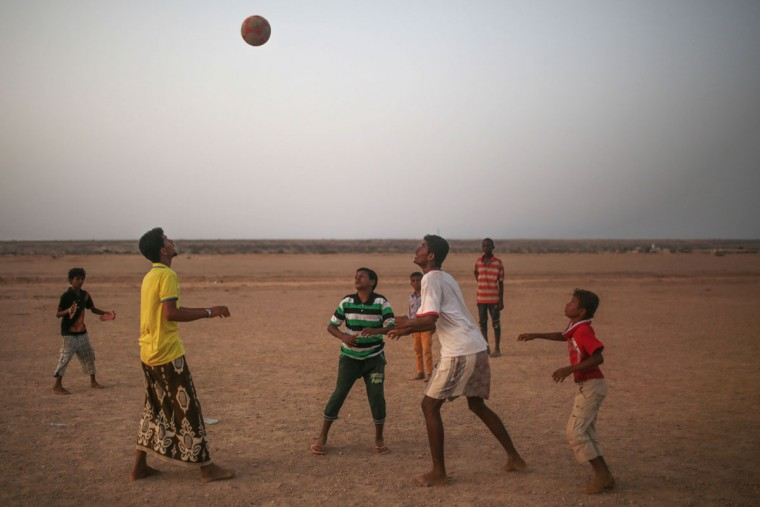 Yemeni refugees play football outside the Markaze refugee camp where Yemeni refugees are stationed, in Obock, northern Djibouti. Many of the refugees are relieved to have escaped after two months of Saudi-led airstrikes targeting Yemenís Shiite rebels and fighting on the ground between rival factions that have pushed their country to the brink of collapse. (AP Photo/Mosa'ab Elshamy)