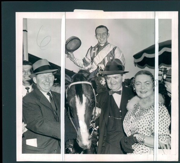 May 23, 1954 - WINNER'S CIRCLE - Hasty Road, with Jockey Johnny Adams in the stirrups, poses in winner's circle with Mr. and Mrs. Allie Ruben, his owners, after capturing the 78th running of the Preakness at Pimlico yesterday. Hasty Road is wearing a garland of Black-eyed Susans. (Joseph A. DiPaola/Baltimore Sun)