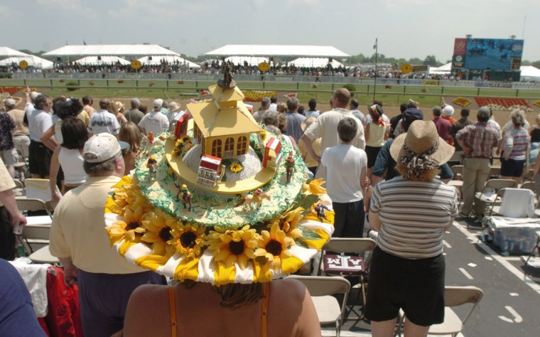 Tara Catalano makes her Preakness hats herself. It took 3 weeks to make. She comes to The Preakness with a different hat for last 3 years. This hat has working slot machines around the brim. (Kenneth Lam/Baltimore Sun)